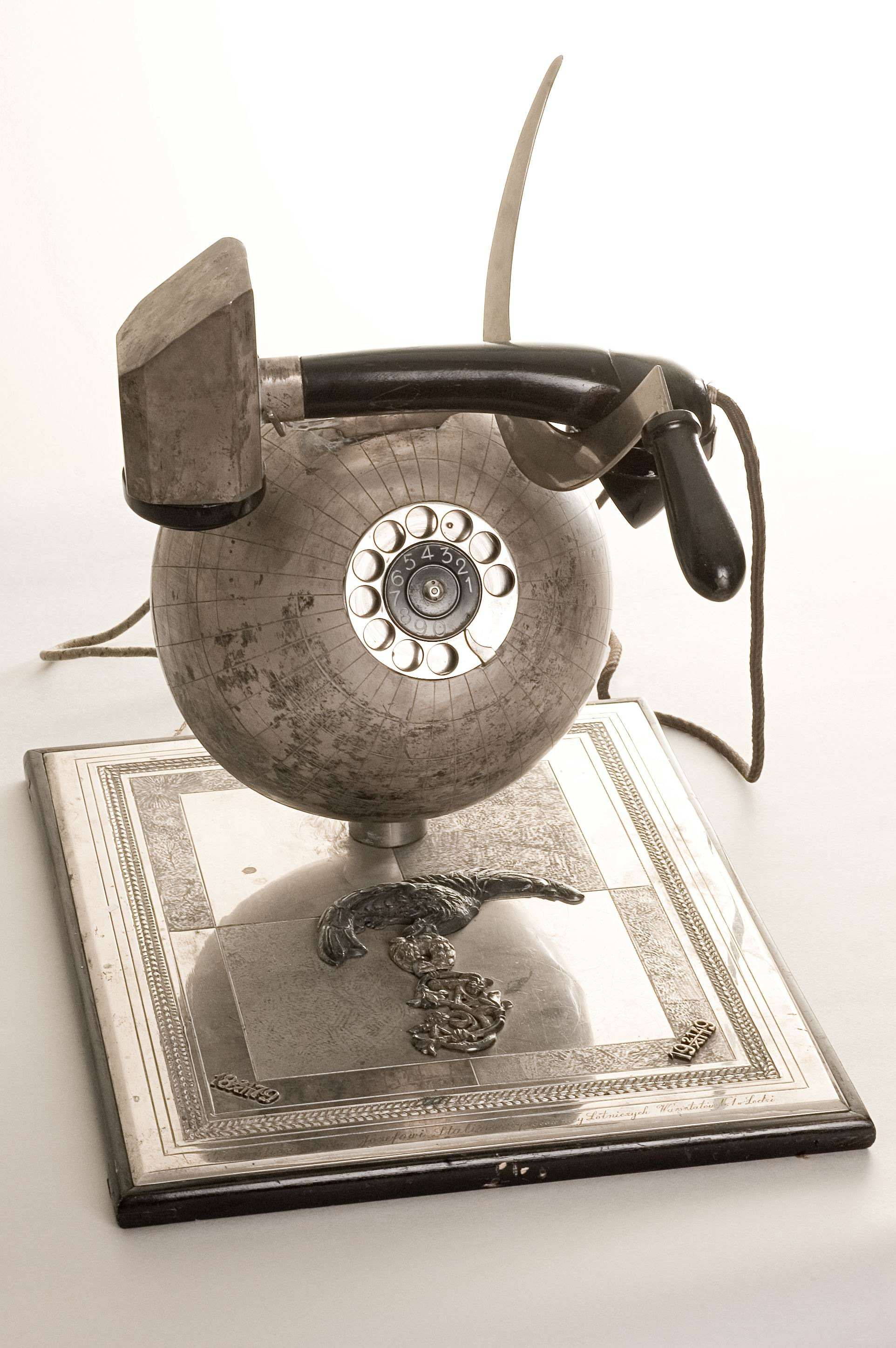 Telephone set in the form of the globe with receiver as a hammer and sickle A gift to J.V.Stalin for his 70th birthday from workers of the aircraft workshop No. 1.Lodz, Polish Republic, 1949. Metal, enamel, plastic and wood Courtesy of the State Central M